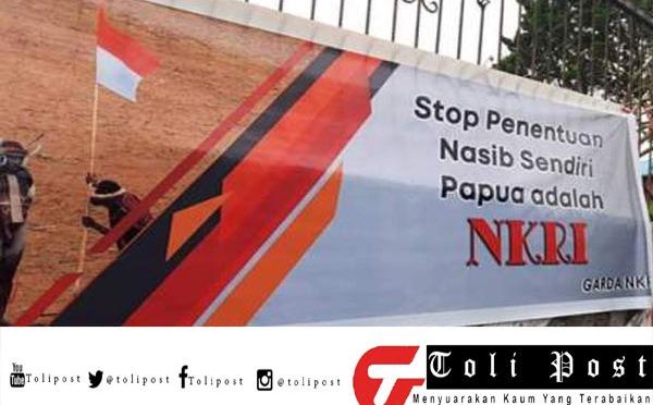TNI/Polri telah Memasang Baliho dua tempat yang berbeda di kota Tomohon